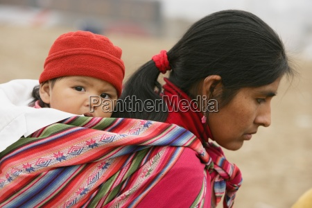 mother with child slung on back