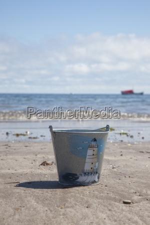 pail on beach boulmer beach northumberland