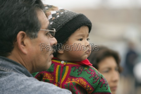 father holding child lima peru