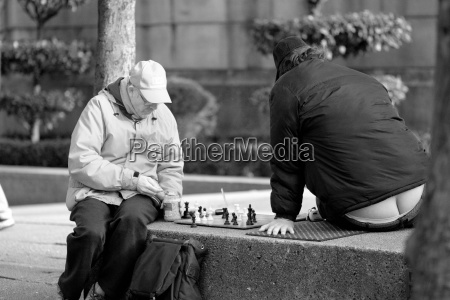 men playing chess outdoors