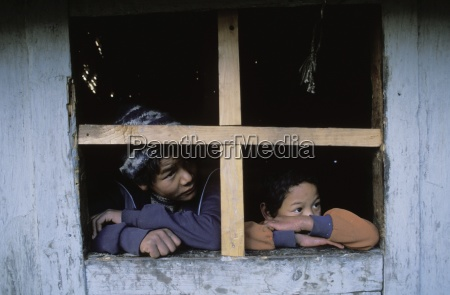 children look out window lukla solo