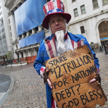 street performer begging on wall street