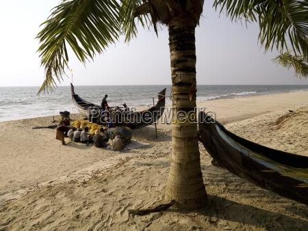 fishermen checking their nets arabian sea