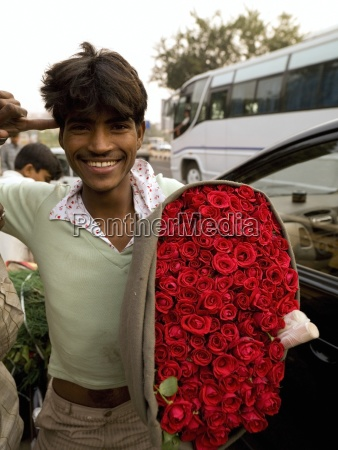 humorous young man holding large bunch