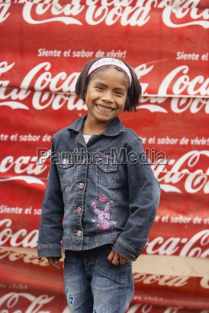 young girl in front of peruvian