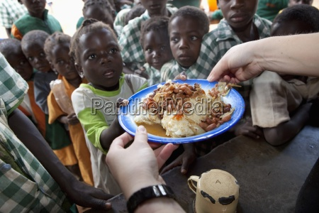 children being served a meal at