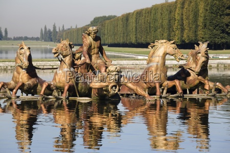 statue of men and horses reflected