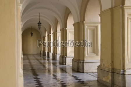 a corridor with tile floors and