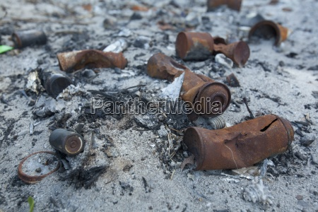 burned garbage and aerosol spray cans