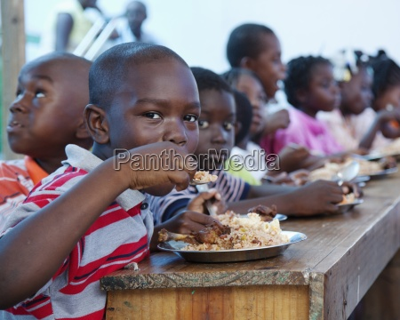 children eating a hot meal port