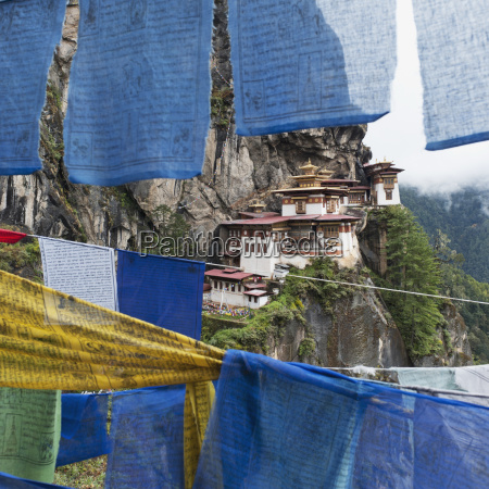 prayer flags hanging in front of