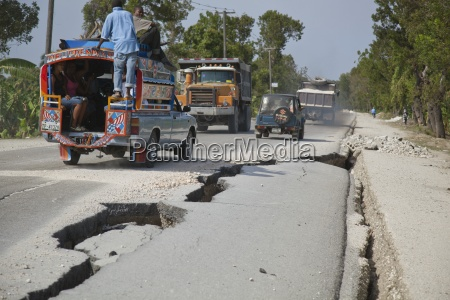 large cracks in the road after
