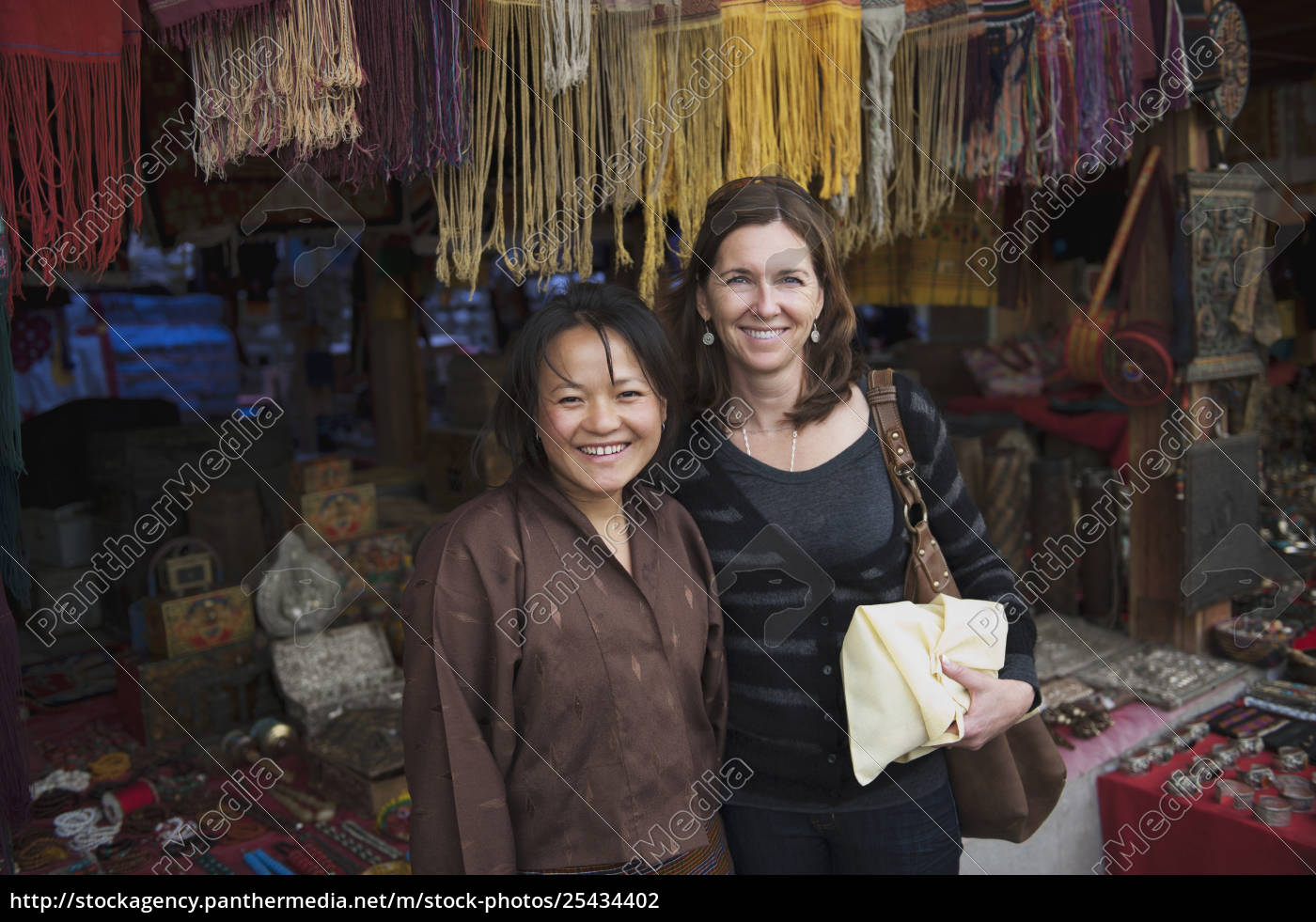 Two Woman At A Market With Bhutanese Handicrafts Rights Managed