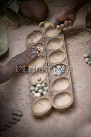 playing a game with marbles senegal