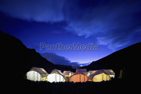 tents illuminated in a valley at