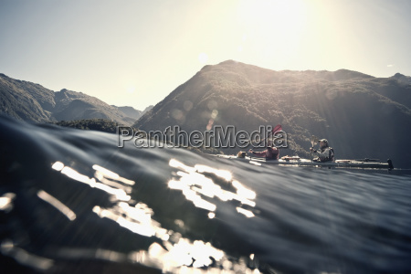two people kayaking in doubtful sound