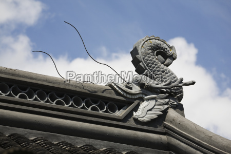 sculpture of a dragonfish eating the