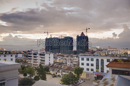 cranes working on highrise buildings with