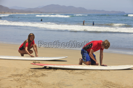 instructors and students with surf lessons