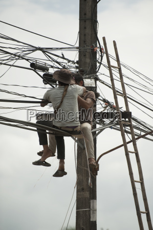 technicians working on the wires mae