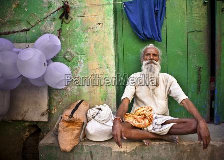 a man sits cross legged on