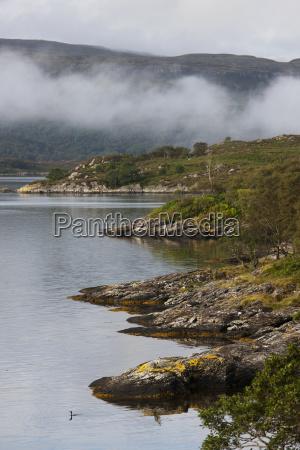 low hanging cloud along the shoreline