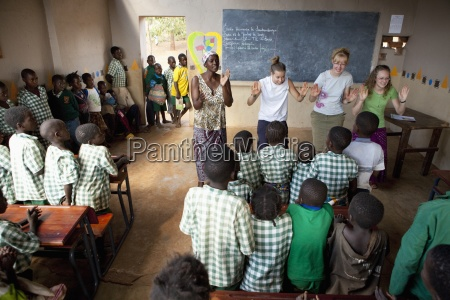 women teaching a classroom of students
