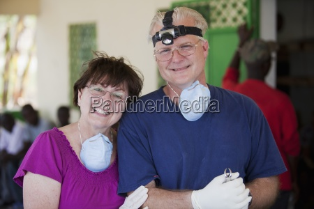 a dentist and his mother volunteer