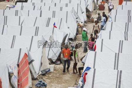 internally displaced people outside their tents