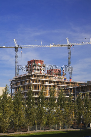 construction work cranes over an unfinished