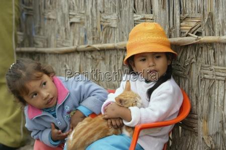 children snuggling with cat lima peru