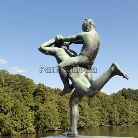 sculpture of a child riding on