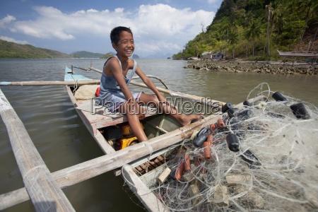 a young filipino boy smiles as