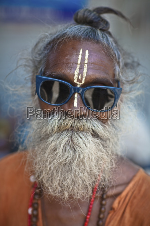 a holy man wearing sunglasses with