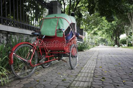 rickshaw on the sidewalk solo java