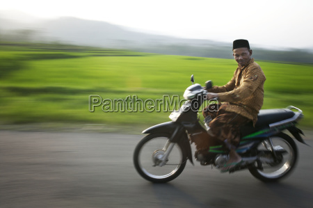 man riding by on a motor