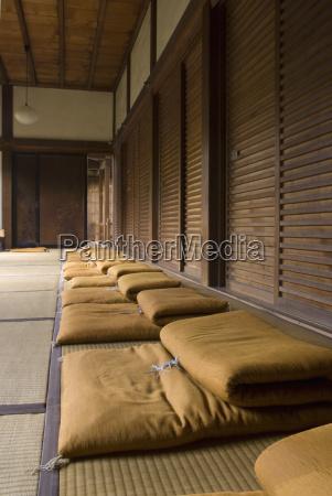 row of meditation cushions in a