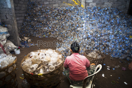 a local worker sifts through an