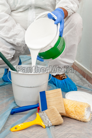 house painter at work prepares white