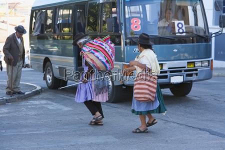 aymara woman helping a blind woman