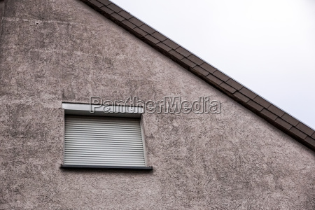 window with closed shutters security blinds
