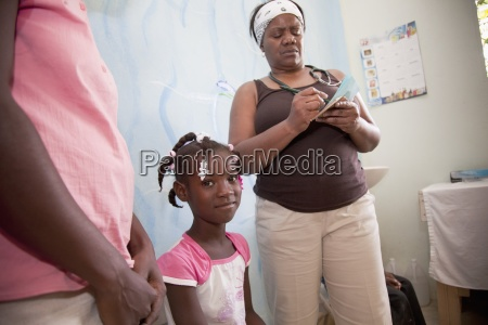 a nurse seeing young haitian patients