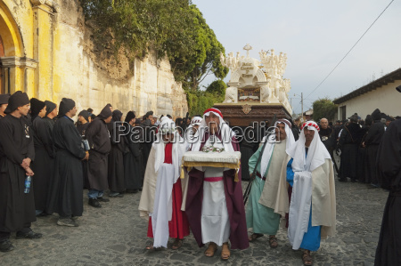 men dressed in mourning carrying the