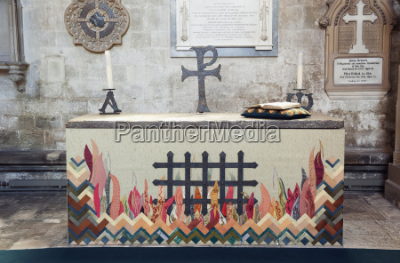 flames depicted at an altar in