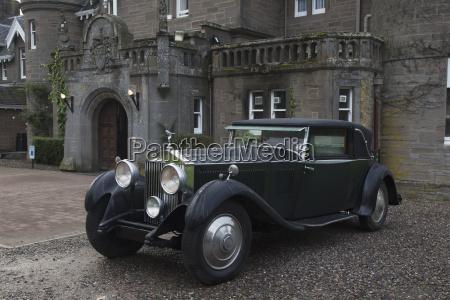 vintage black car parked outside a
