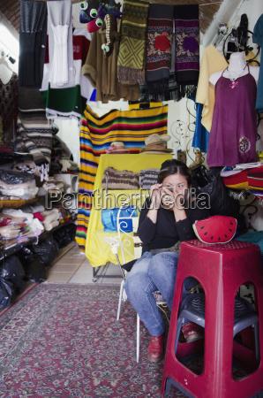 souvenir vendor applying makeup in her