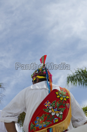 rear view of man wearing traditional