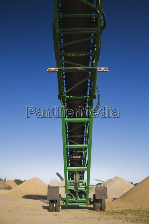 stacking conveyors and mounds of sand