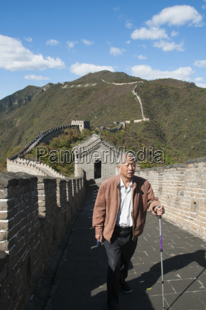 man walking in mutianyu section of