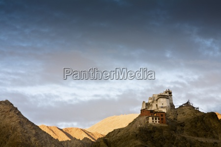 lone building sitting atop rugged mountain